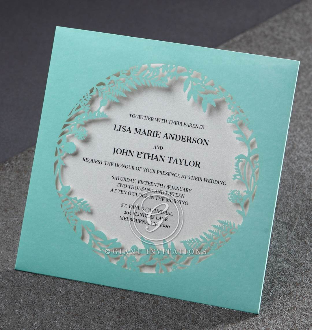 Laser cut pocket invitation featuring a wreath window, pearl paper ...