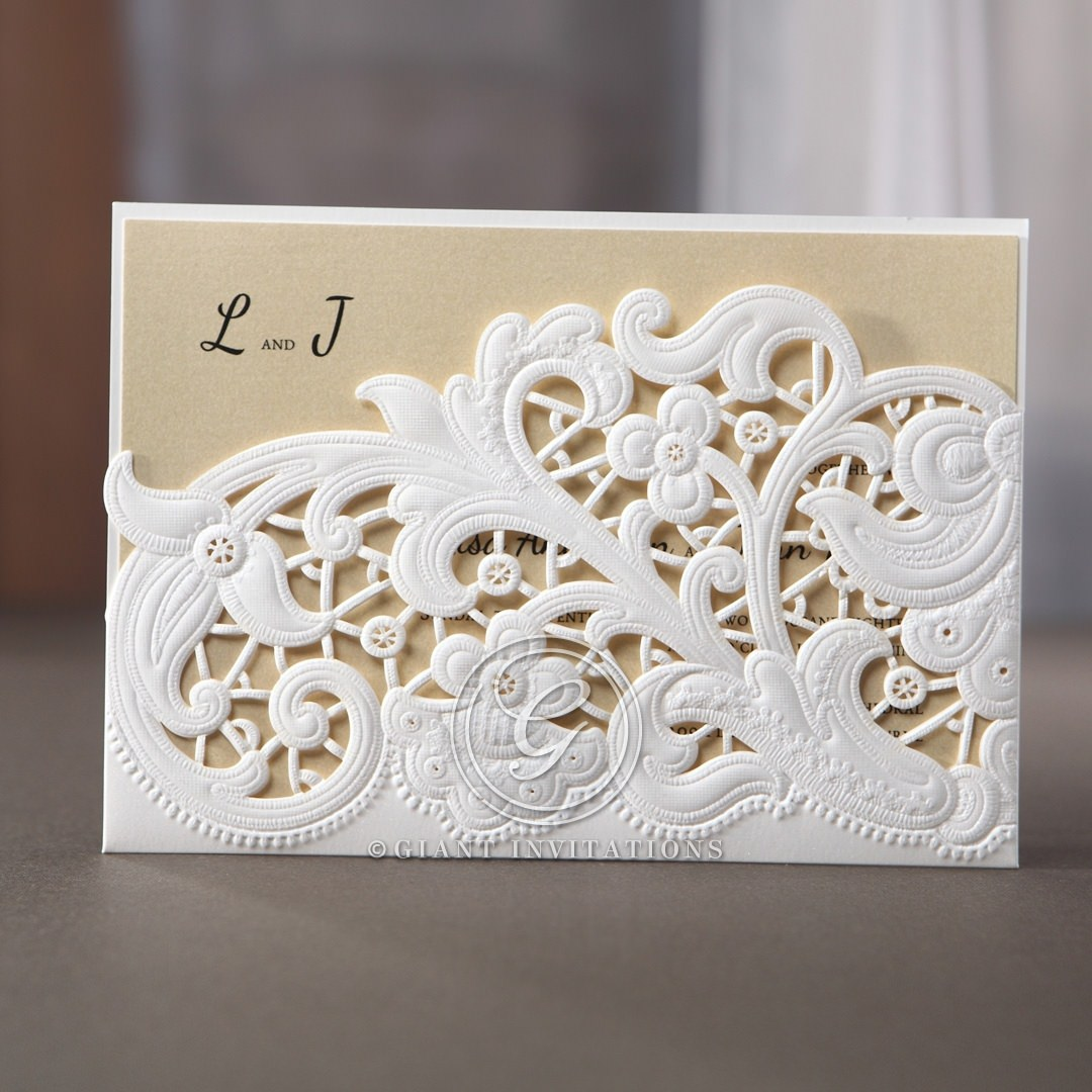 Jewel embellished matte laser cut pocket featuring blue insert and embossed floral swirls