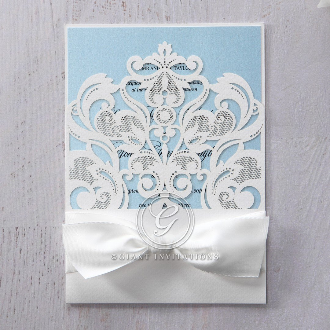 Matte white pocket invite with Victorian theme lasercut front cover, wrapped with a smooth white satin lace ribbon
