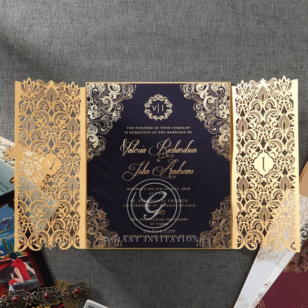 Hot foil stamped navy blue invite with golden laser cut sleeve