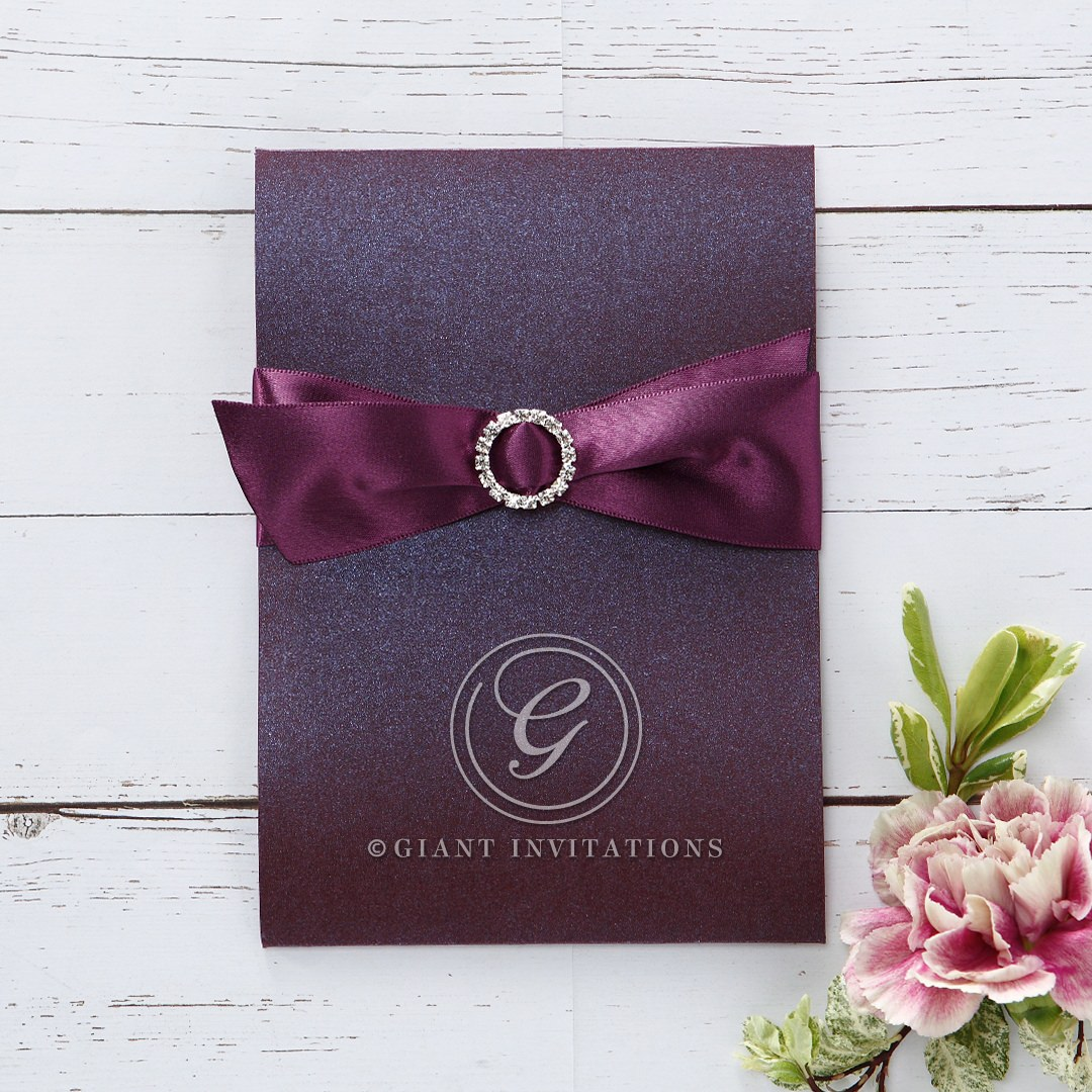 Rectangular pocket invite with deep marsala coloured pearlised card stock with smooth satin ribbon and circular crystal jewel