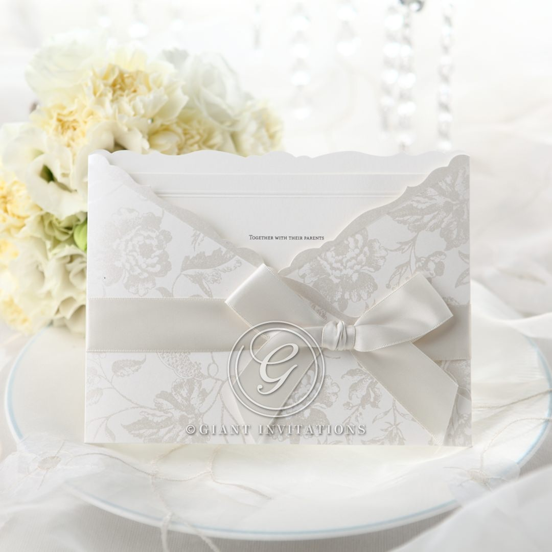 Elegant pocket invite with white satin ribbon, silk screened in silver floral design