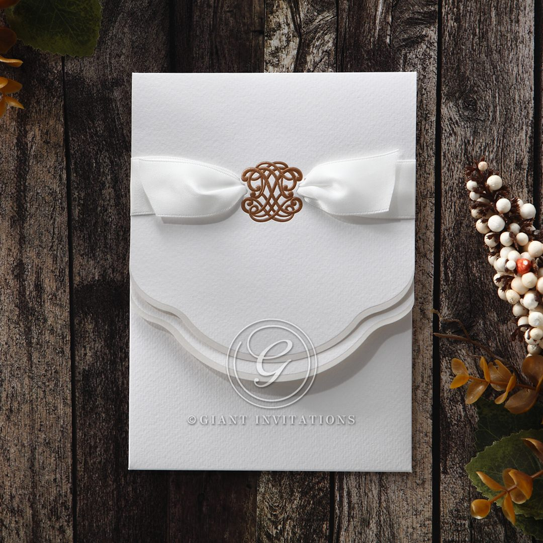 Lightly textured pocket invite, with mini pocket, wrapped with white ribbon and gold emblem center