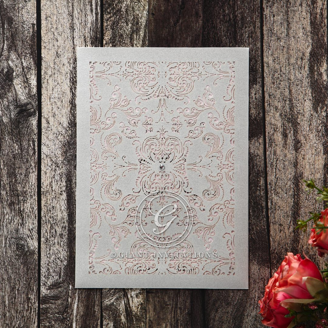 Silver metallic pocket invite adorned with a crystal jewel stud with a see-through light pink pearlised inner card