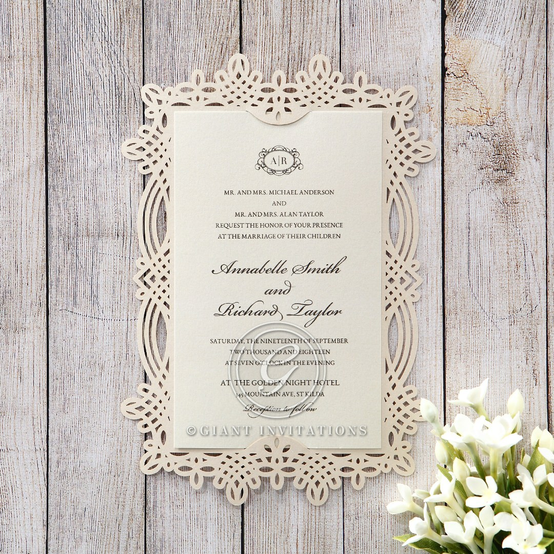 Vintage themed lasercut border on the beige backing card enclosing the cream insert card with raised ink fonts