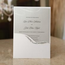 Half pocket invitation with embellished pocket and gray insert in shimmer paper