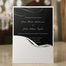 Black and white wedding invited featuring foil stamp and silkscreened paper, half pocket, jewels and digital print