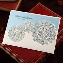 Rustic blue pocket invitation with laser cut patterns