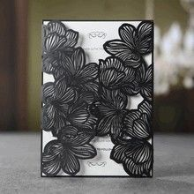 Black laser cut invitation, floral wrap, white inner paper