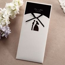 Ivory pocket invite with traditional bride groom laser die cut design, black ribbon and inner card