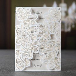 Dazzling pearlised inner card printed in raised ink enclosed in a sophisticated die cut floral laser cut design, encased in a matching pearl envelope with silk lining