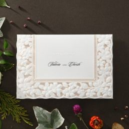 Charming embossed floral patterned laser cut cover with a light pink panel that opens to the main invite printed in customisable fonts