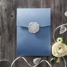 Elegant silk screened insert card with vintage themed borders printed in raised ink enclosed in a pearlised royal blue pocket sealed with a silver wax stamp
