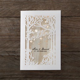 Trifold card digitally printed to give an earthy feel embellished with golden dainty flowers, inserted in a forest themed die cut pattern outer cover