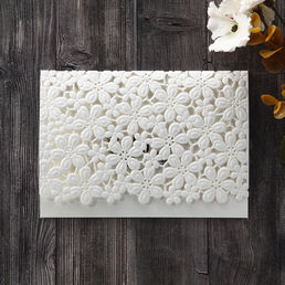 Embossed die cut flower patterned card cover, enclosing a matte white card, printed in raised ink with a complimentary pearlised envelope with silk lining