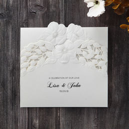 Cheap invitations cards for weddings budget range dreamy white invite with embossed die cut floral center highlighting the couples names solutioingenieria Choice Image