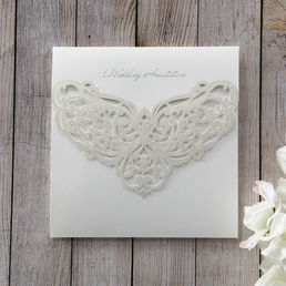Heavenly angel wings patterned die cut front cover with pre-stamped silver foiled lettering enclosing a lightly textured matte white card