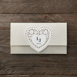 Envelope fold invite with a lovely embossed heart shaped center highlighting the couple's initials enclosed in a matching pearlised envelope