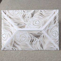 Pearlised ash grey insert card printed in raised ink, draped in an intricate feather patterned laser cut pocket enclosed in a pearlised envelope