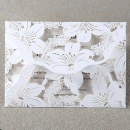 Classic white pocket with wild lilies laser cut folds enclosing a light green pearlised insert card in changeable colours