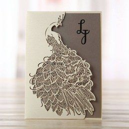 Creamy beige coloured peacock inspired die cut pocket, enclosing a light orange invite in customisable colours