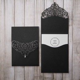 Classic matte white card highlighting the couple's names, inserted in an elegant pearlised black pocket with intricate laser cut cover with a teardrop shaped crystal