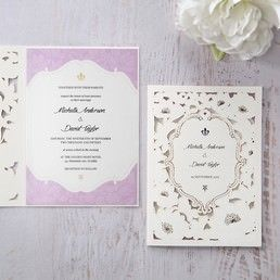 Lavender bordered insert card with dainty golden emblem, attached to an intricate floral laser cut sleeve embellished with gold foiled pollen dots