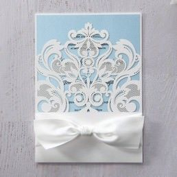 Heartwarming light blue insert card printed in high rise fonts, draped in a floral laser cut pocket bound by a white silky ribbon