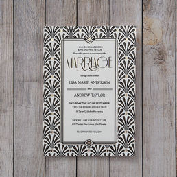 Elegant Vegas themed invite in black and white embellished with golden dots and surrounding inner frame