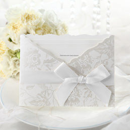 Embossed white inner card with raised ink printing, enclosed in a silk-screened pocket with silver floral decoration