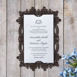 Rectangular deep brown card in vintage themed laser cut frame enclosing a classic white card with customisable monogram initials