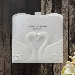 Shimmering silver pearl insert card enclosed in a stunning pocket with embossed swans forming a heart shaped center