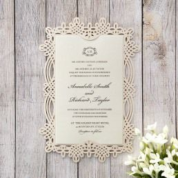 Eye-catching vintage themed card with sophisticated laser cut details, cradling a matte, cream coloured insert card printed in raised fonts
