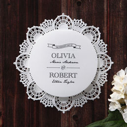 Eye-catching circular invite surrounded by embossed laser cut crown shaped design border, enclosed in a pearlised paper with silver lining