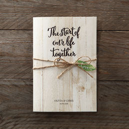 Earth toned invite printed in raised calligraphic lettering inserted in a matching wooden theme pocket bound by a sweet twine