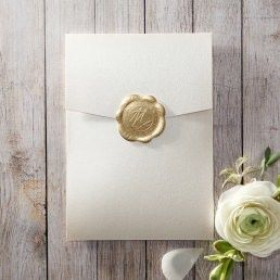 Dashing cream coloured pocket enclosing a silk-screened insert card with golden borders and customisable monogram initials