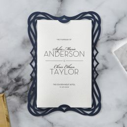 Classic matte white lightly textured insert card, printed in calligraphic writing, inserted in a deep navy blue laser cut bordered backing layer