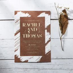 Rustic brown craft, hot foil stamped in gold script, white brush stroke background