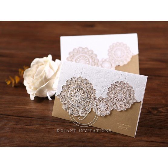 Two gold trifol wedding invitations, lasercut, embossed floral design