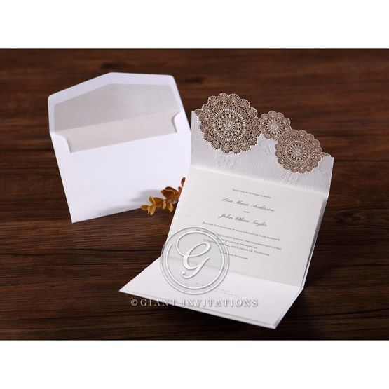Opened gold vintage trifold wedding invitation, white inner paper