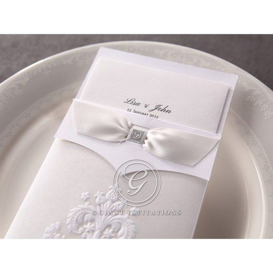 Traditional white embossed wedding invitation in rectangle featuring embossed pocket and white ribbon