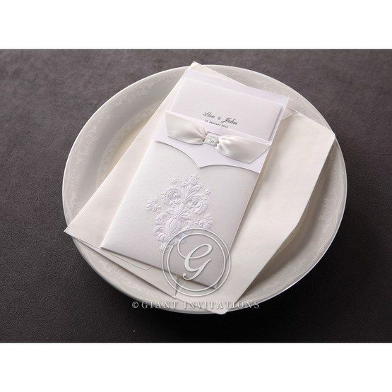 The traditional white embossed damask pocket invitation with its matching envelope