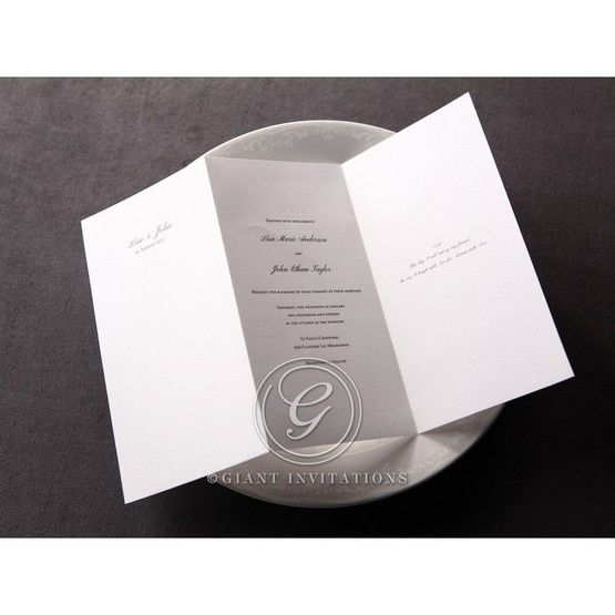 Tri fold white insert out of its matte white embossed designed pocket featuring thermohraphy print