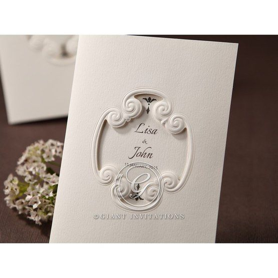 Canvas papered white wedding invitation with custom print accentuated by a frame