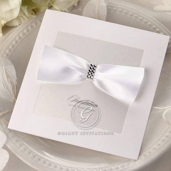 White, square, folded, embellished wedding invitation with ribbon, raised printing, foil stamping