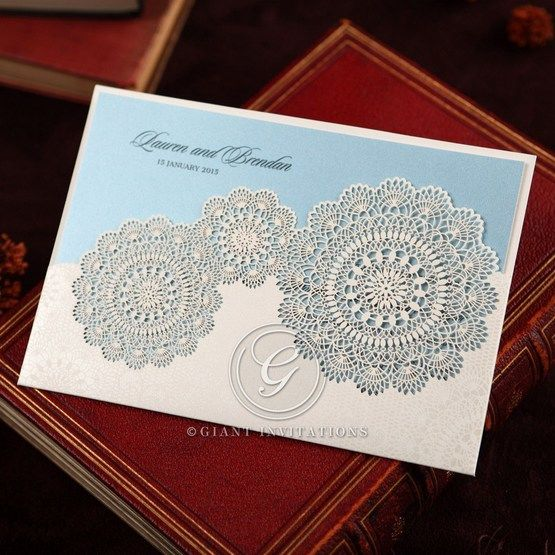 White pocket style lasercut wedding invitation, blue inner paper, matte white pocket, floral lace design