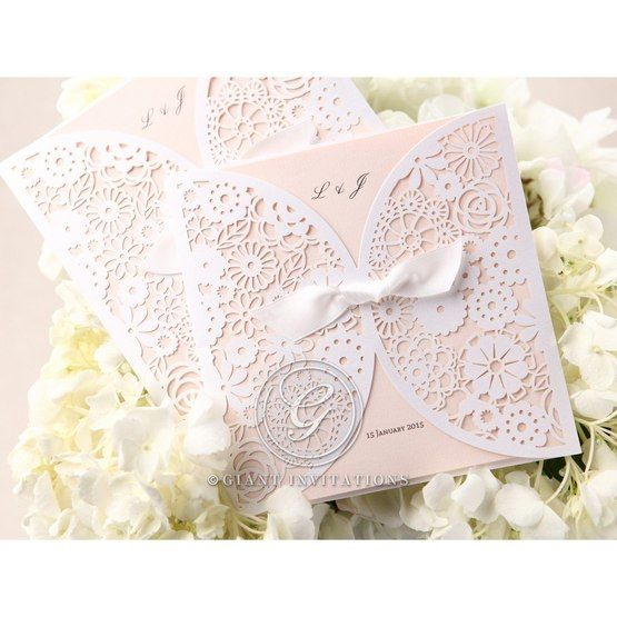 Two pink laser cut wedding invitation; ribboned; pink inner card