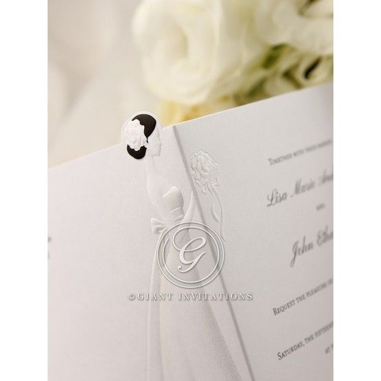 Embossed bride detail, opened wedding invite