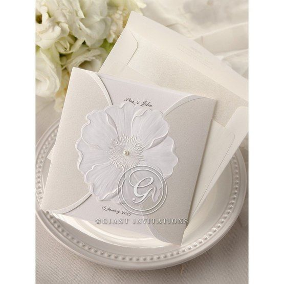 White inner paper,traditional white sculptured urban flower design, gatefold pocket invite