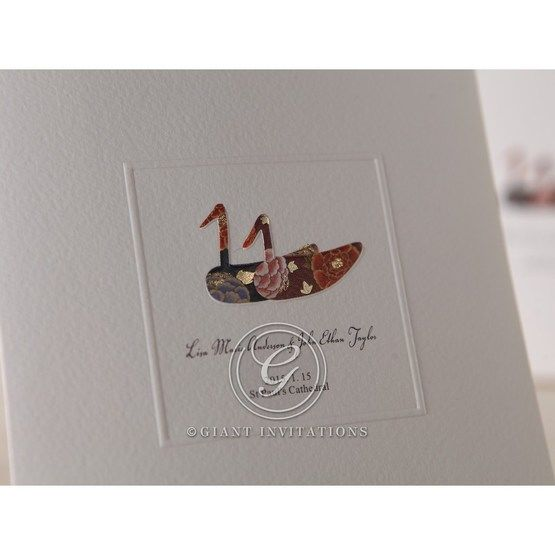 Zoomed in view of the duck detail on the cover, coloured, foil stamped with embossed square frame